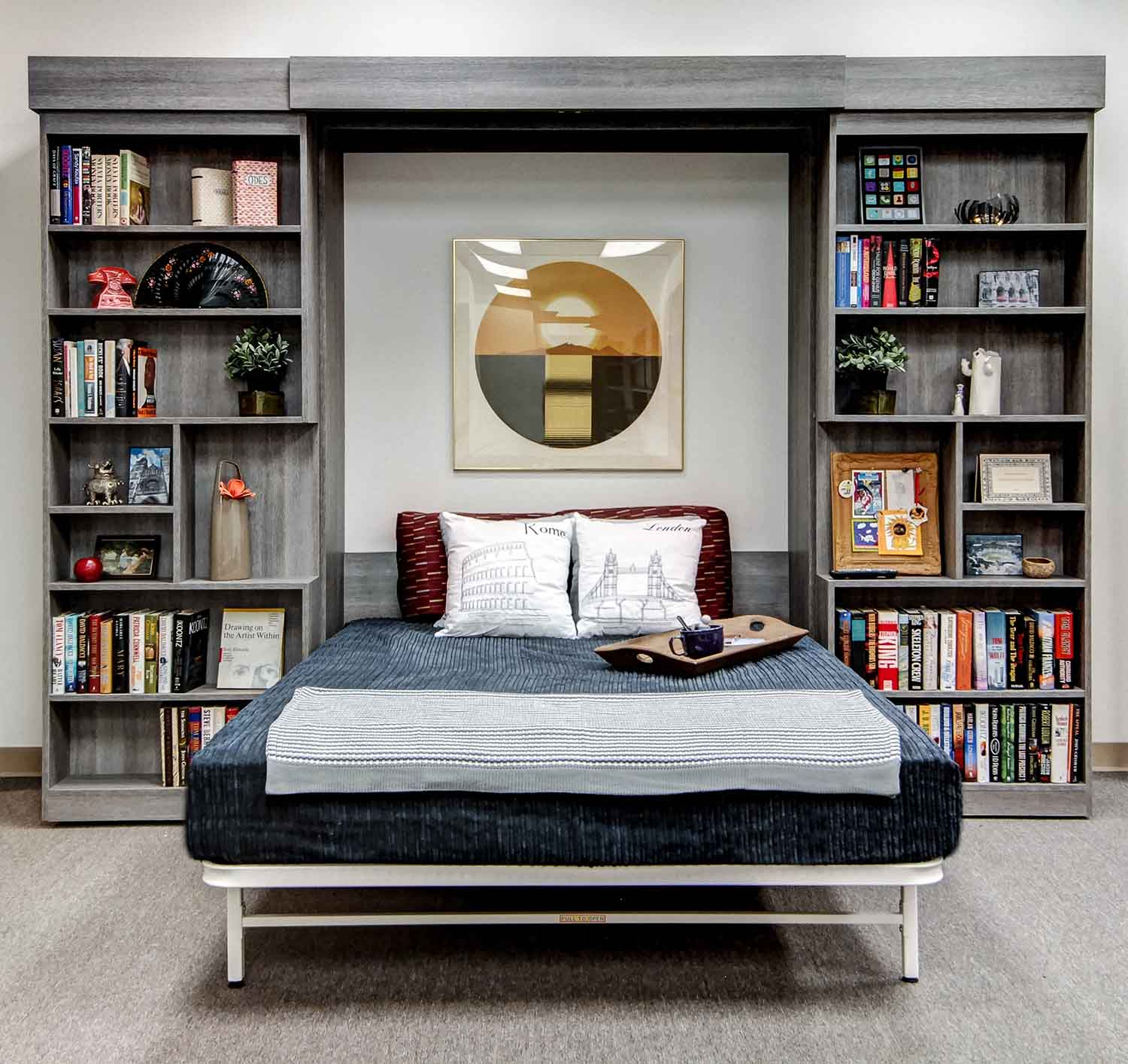 Affordable sliding bookshelf and murphy bed combination