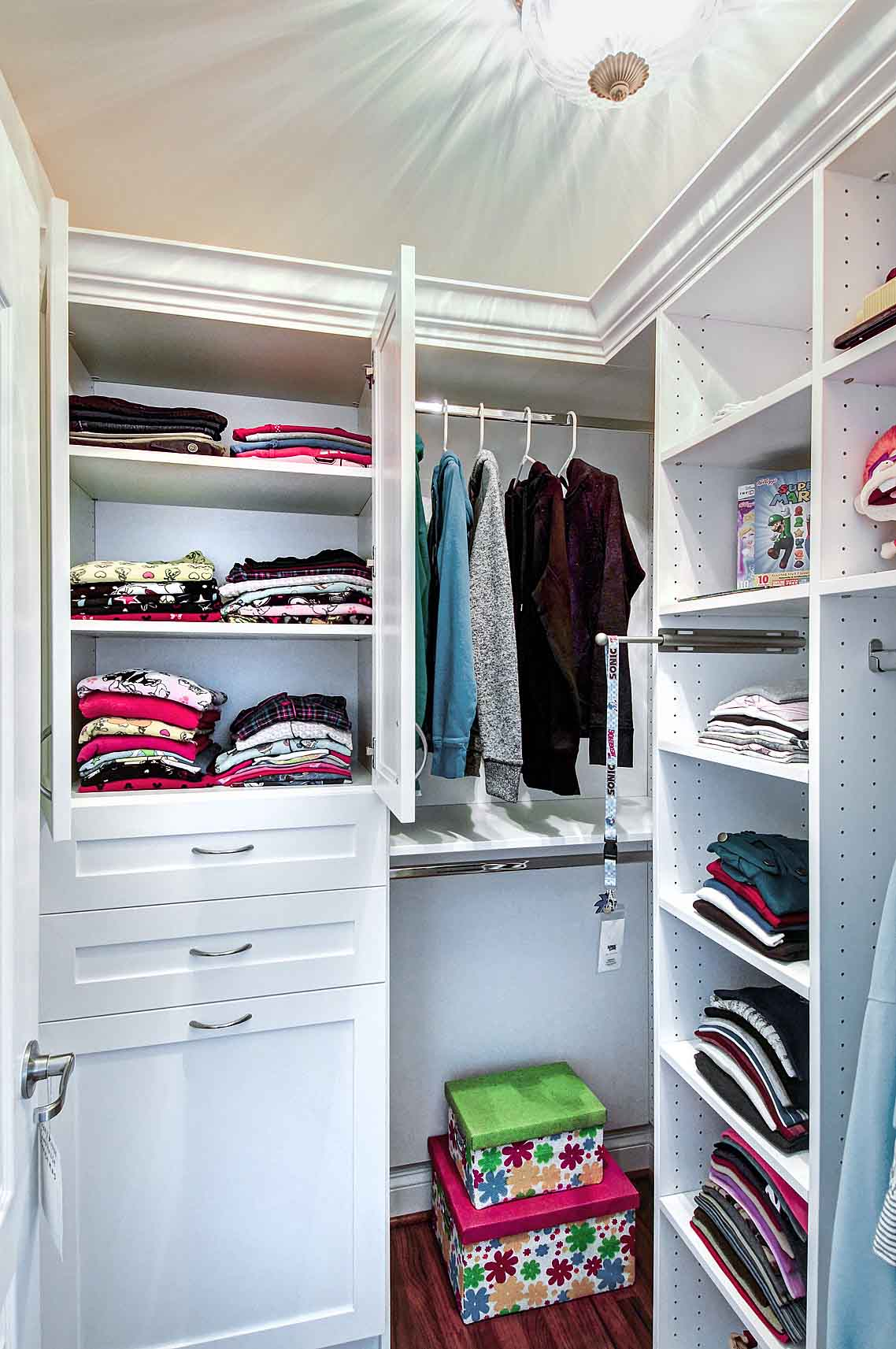 Organized walk-in closet with storage space optimized