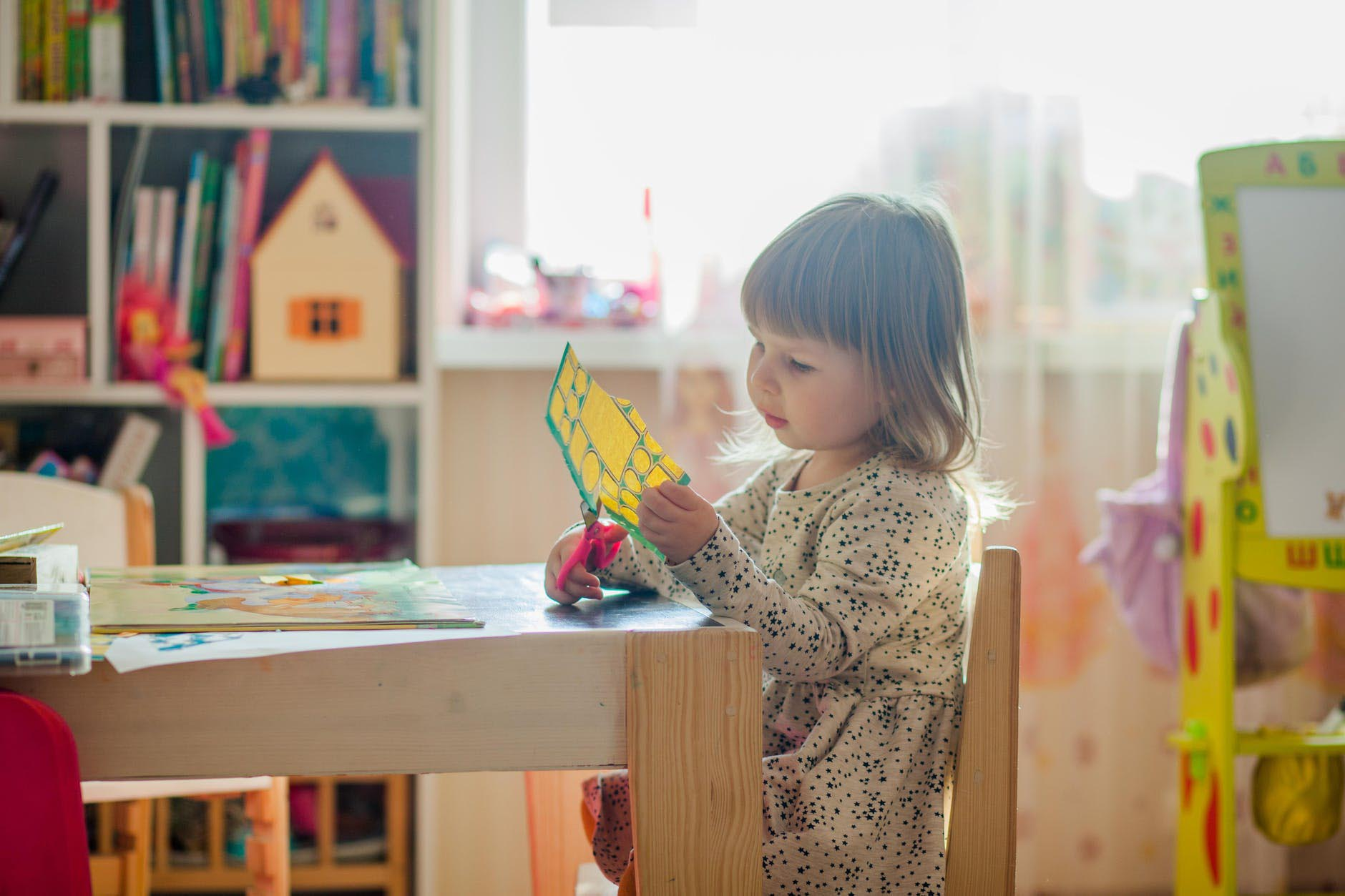 Child playing in organized room