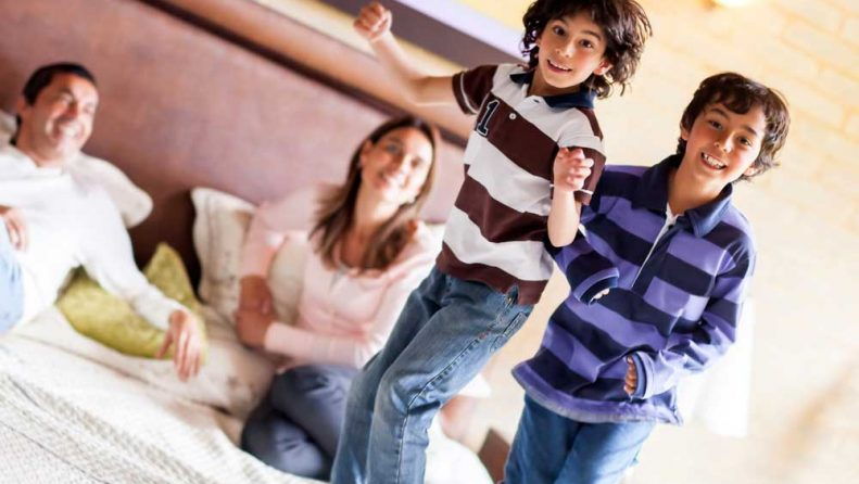 Kids jumping on top of space saving bed