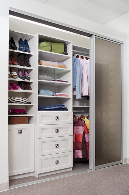 Reach-in closet system with double hanging and slanted shoe shelves