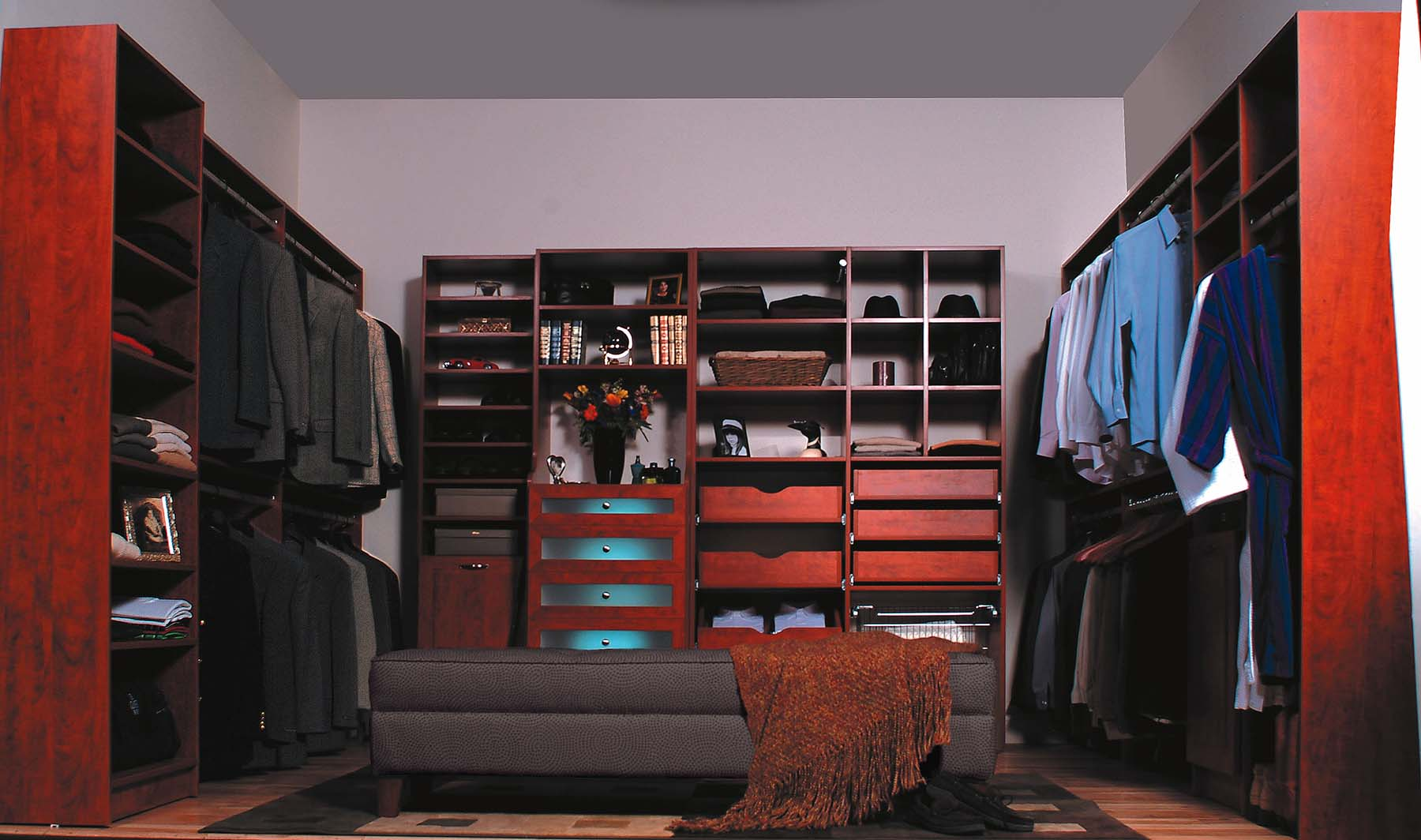 Men's walk-in closet with couch