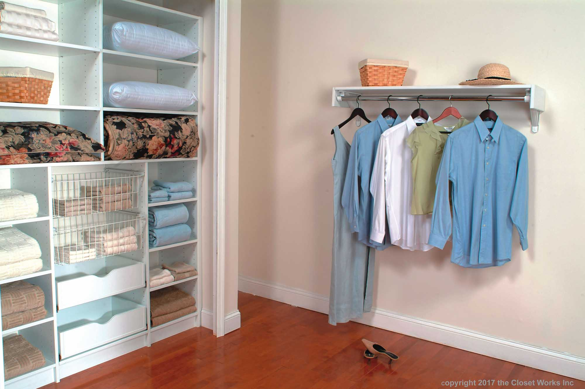 Reach in linen closet with adjacent hanging