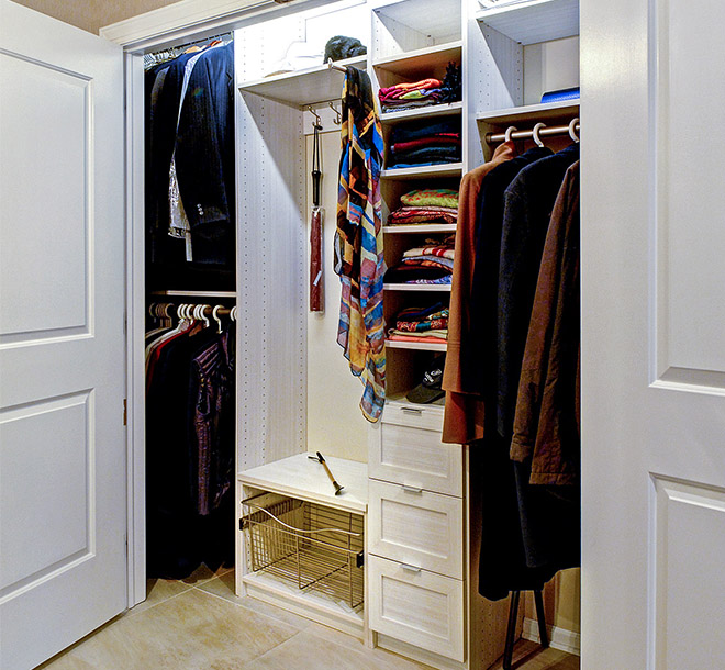 Organized Reach in closet system with clothing neatly hung and folded