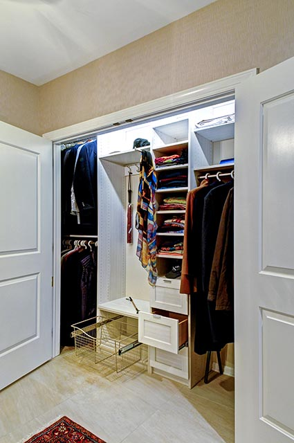 Organized Reach in closet with closet system
