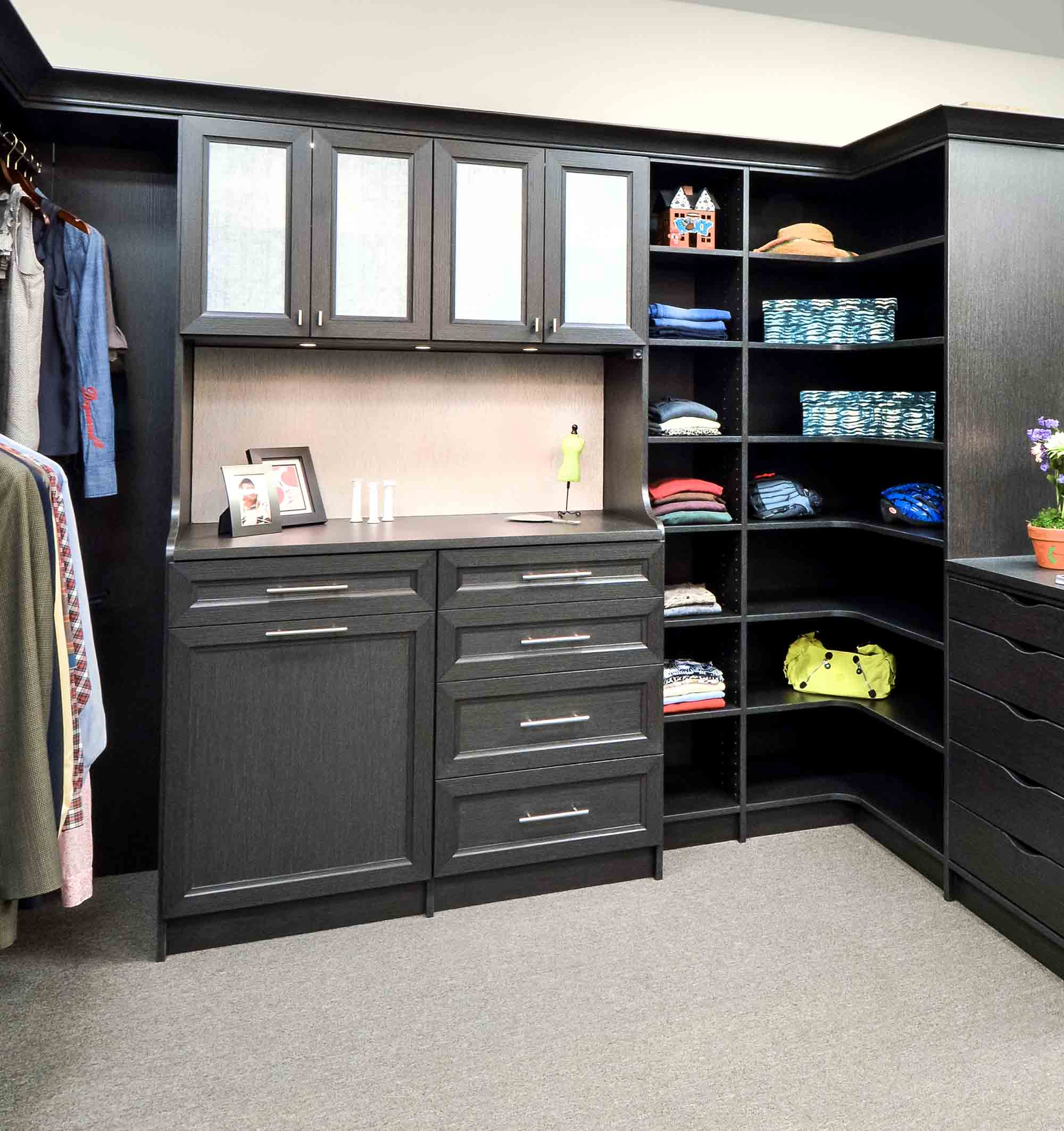 Organized walk in closet with rounded corner shelving