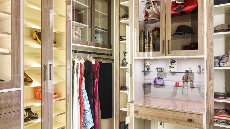 Walk-in closet design with clothes organized