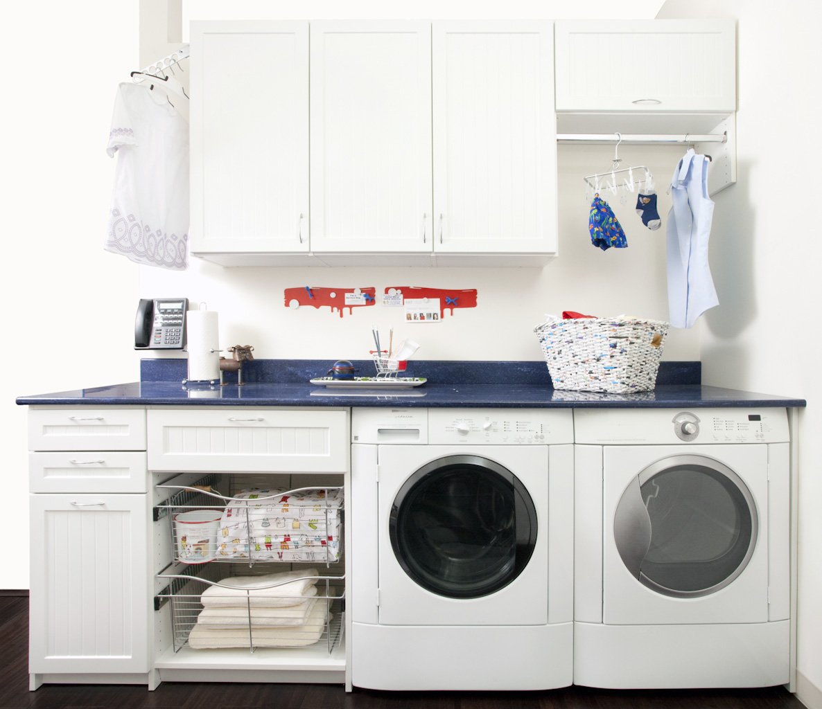 Functional laundry room with cabinets and washer dryer combination
