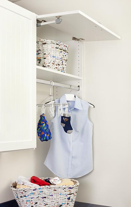 Clothing hung in laundry room to dry