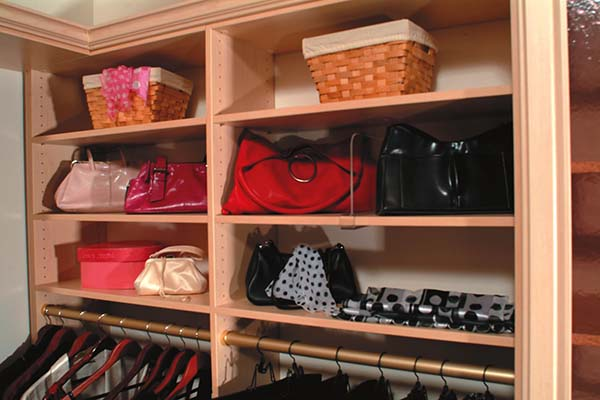 Custom built cubbies with handbags neatly displayed