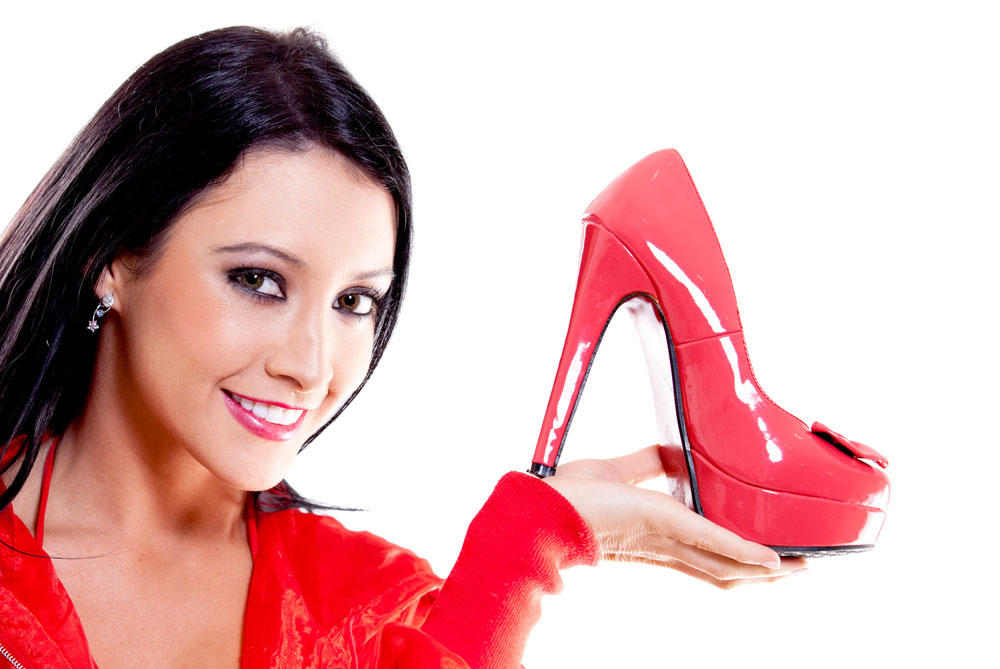 Woman ready to organized her red high heels