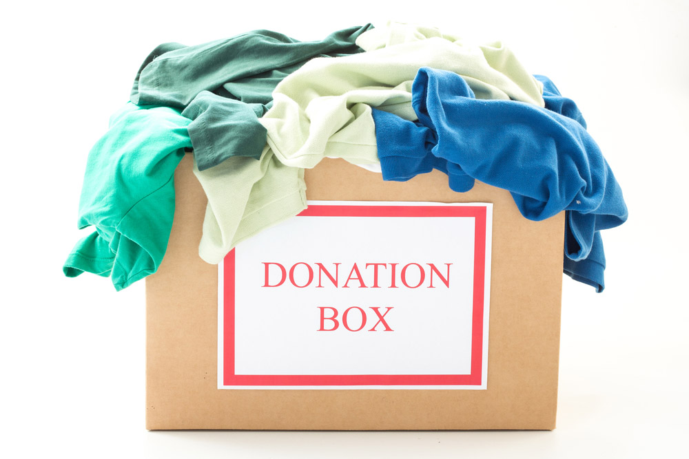 Cardboard donation box filled with clothes