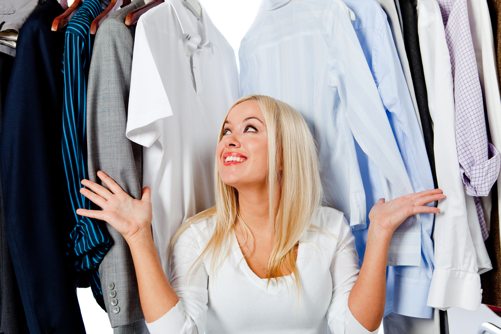 Woman needing a closet design with disorganized clothes