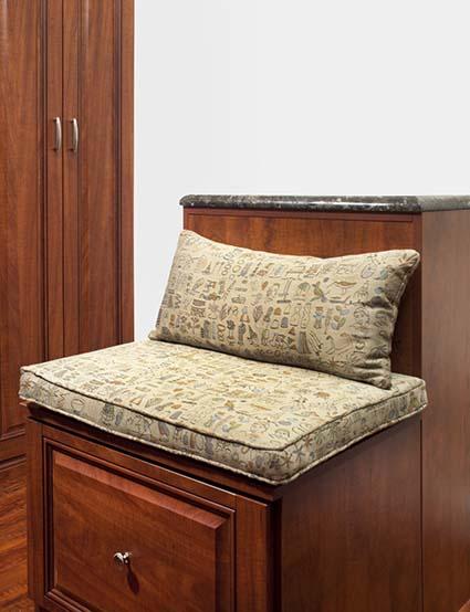 Custom closet with sitting area and center island