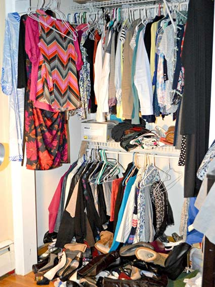 Disorganized closet with shoes piled on the floor