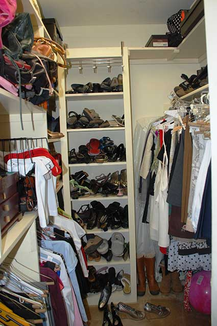Disorganized closet with shoes thrown on shelves