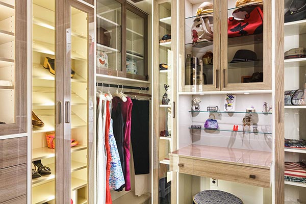 Closet with beautiful lighting and vanity