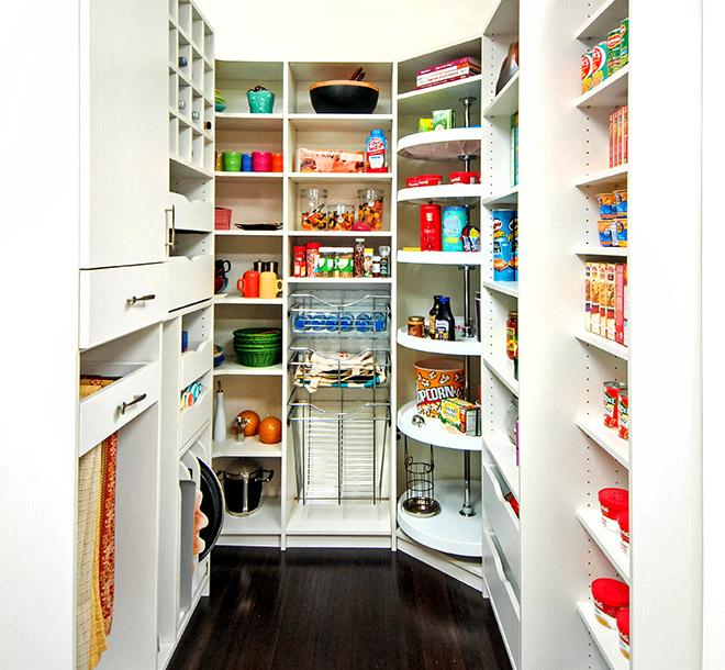 Clean kitchen pantry with Lazy Susan and pull out baskets