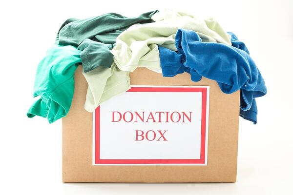 Cardboard donation box filled with fall and winter clothing