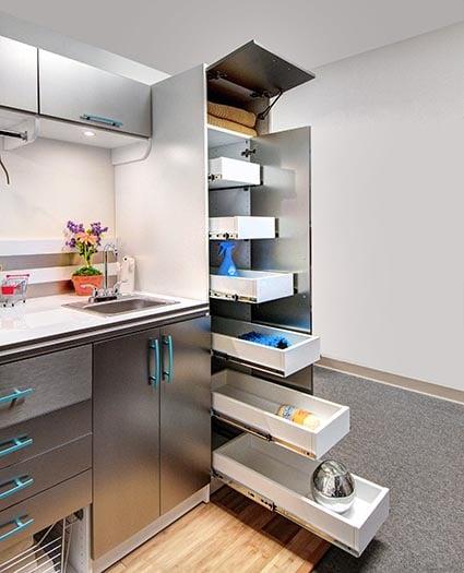 Full length sliding drawers in custom laundry room