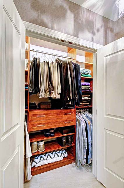 Custom reach-in closet system with shor shelves and double hanging