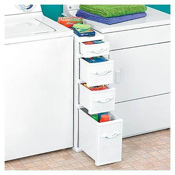 Small drawers organized with cleaning supplies in laundry room