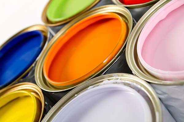 Different color paint cans which shoud never be stored in garage