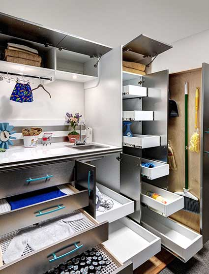 Laundry room items stored in organized slide out drawers