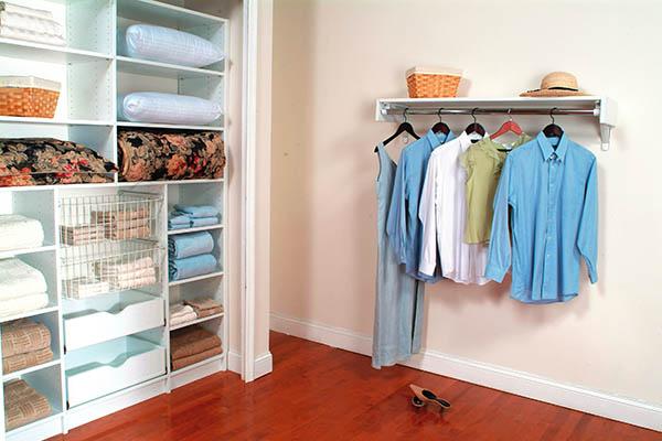 Linen closet neatly organized with custom shelves