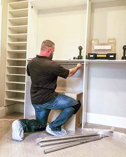 Handyman installing a custom closet system