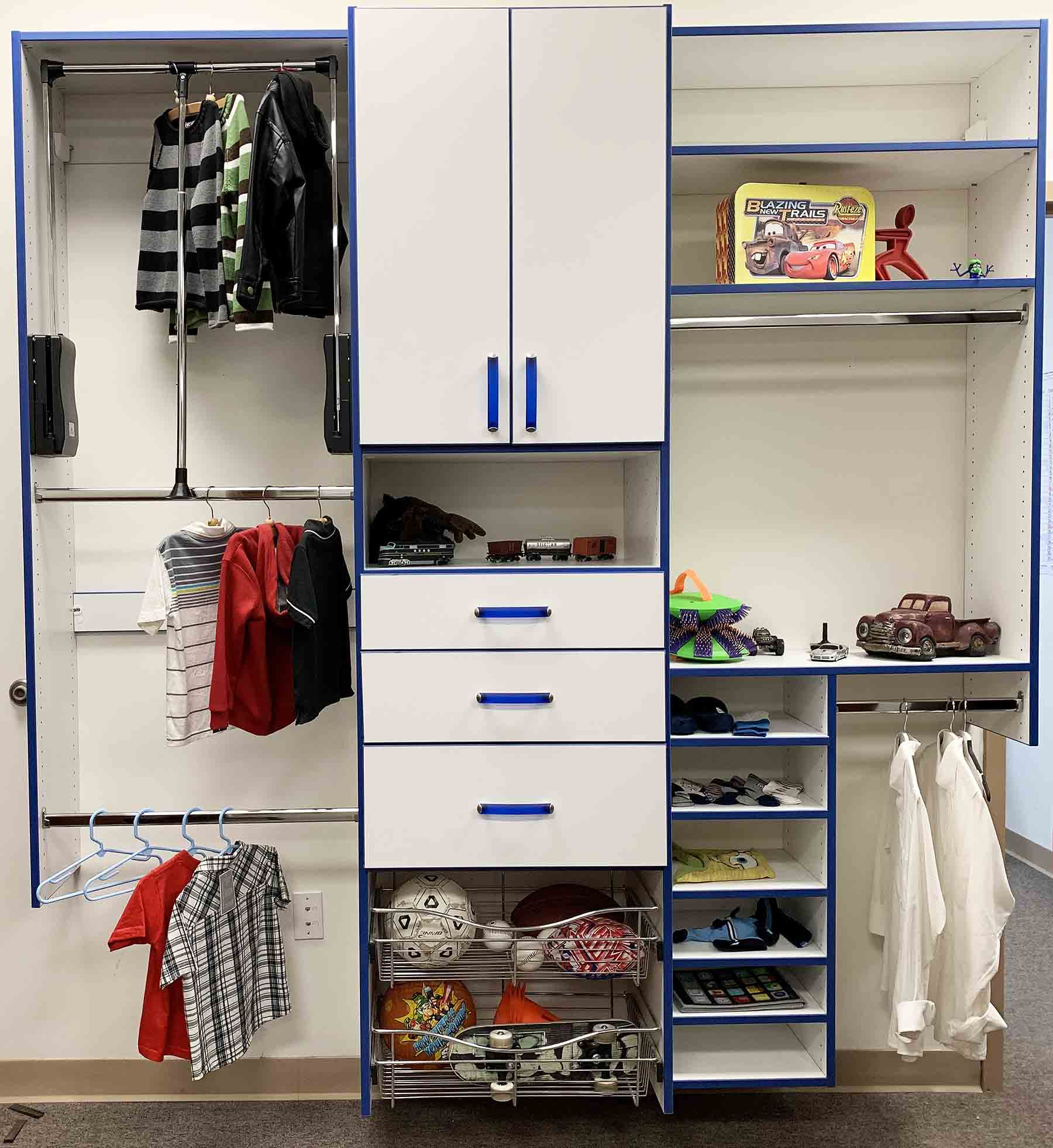 Children's closet with toys and clothes organized