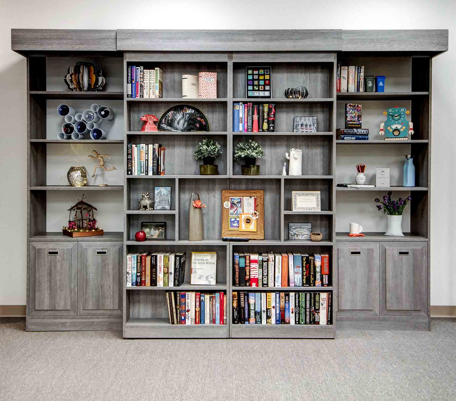Sliding bookcase with Murphy bed