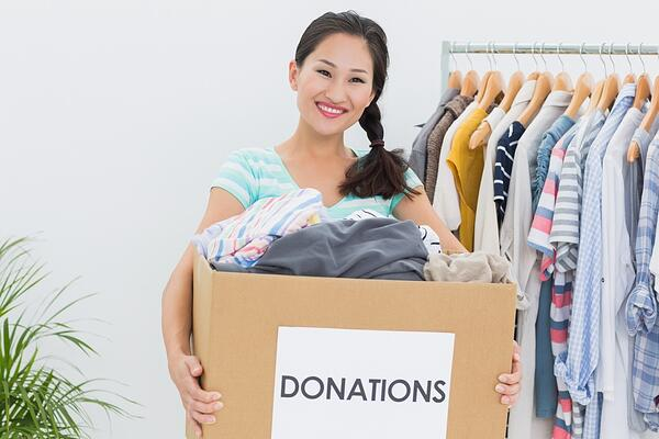 Woman managing her wardrobe and donating clothes