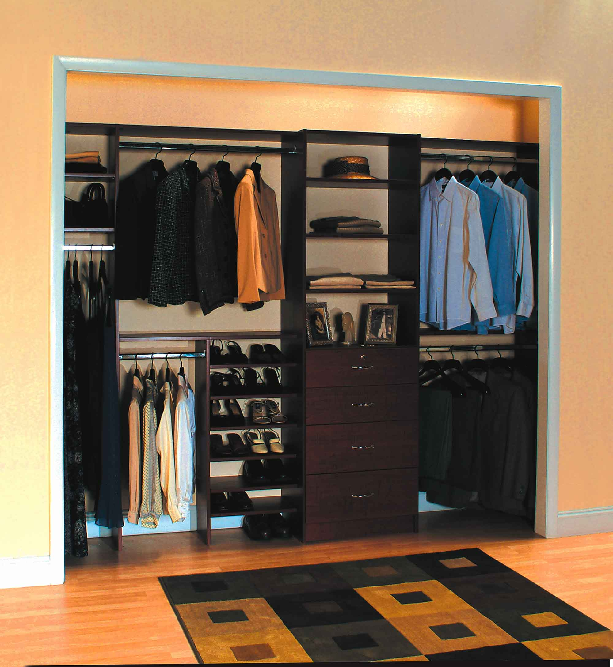 Woman's reach-in closet organized with shelving