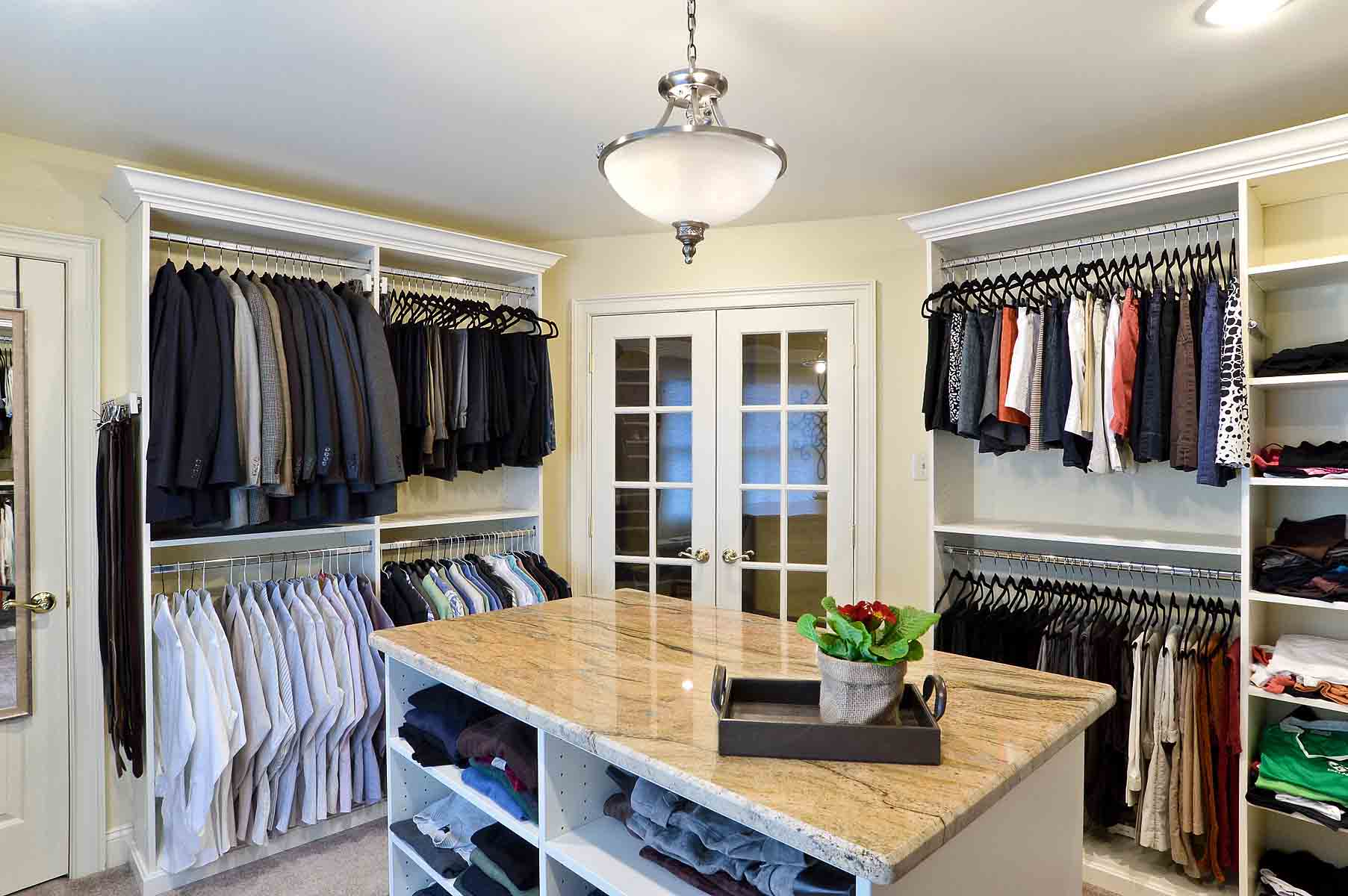 Walk-In Closet with clothing cared for an organized