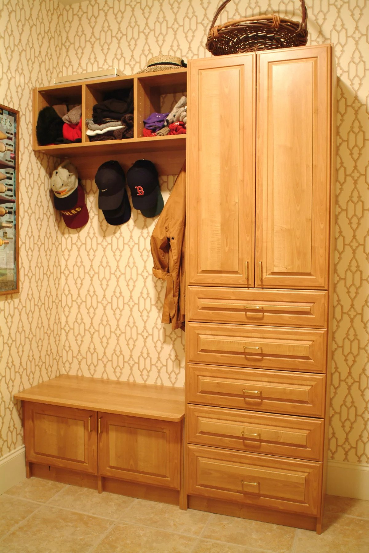 Organized mudroom and entryway with clothing accessories hung and stored in cubbies