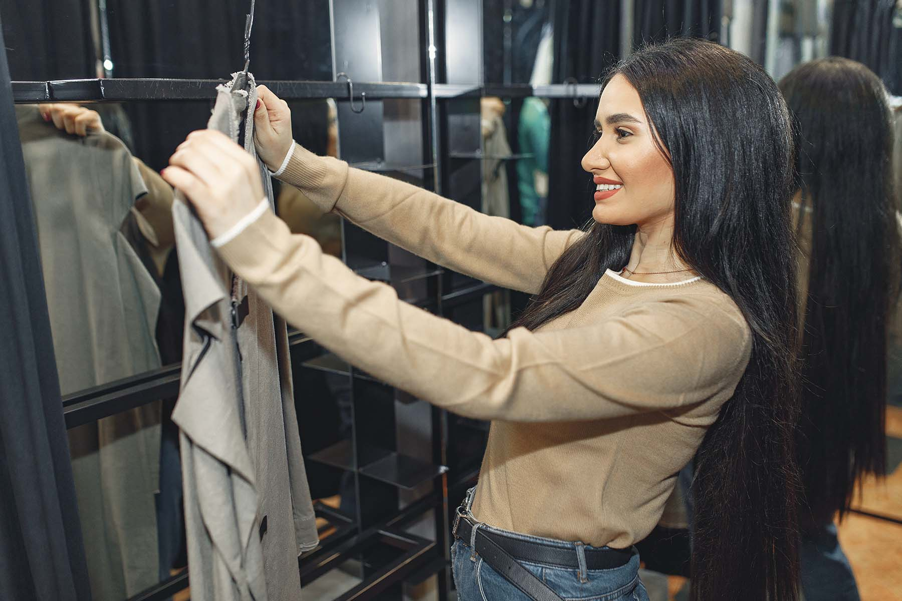 Woman looking at clothing and deciding what to declutter
