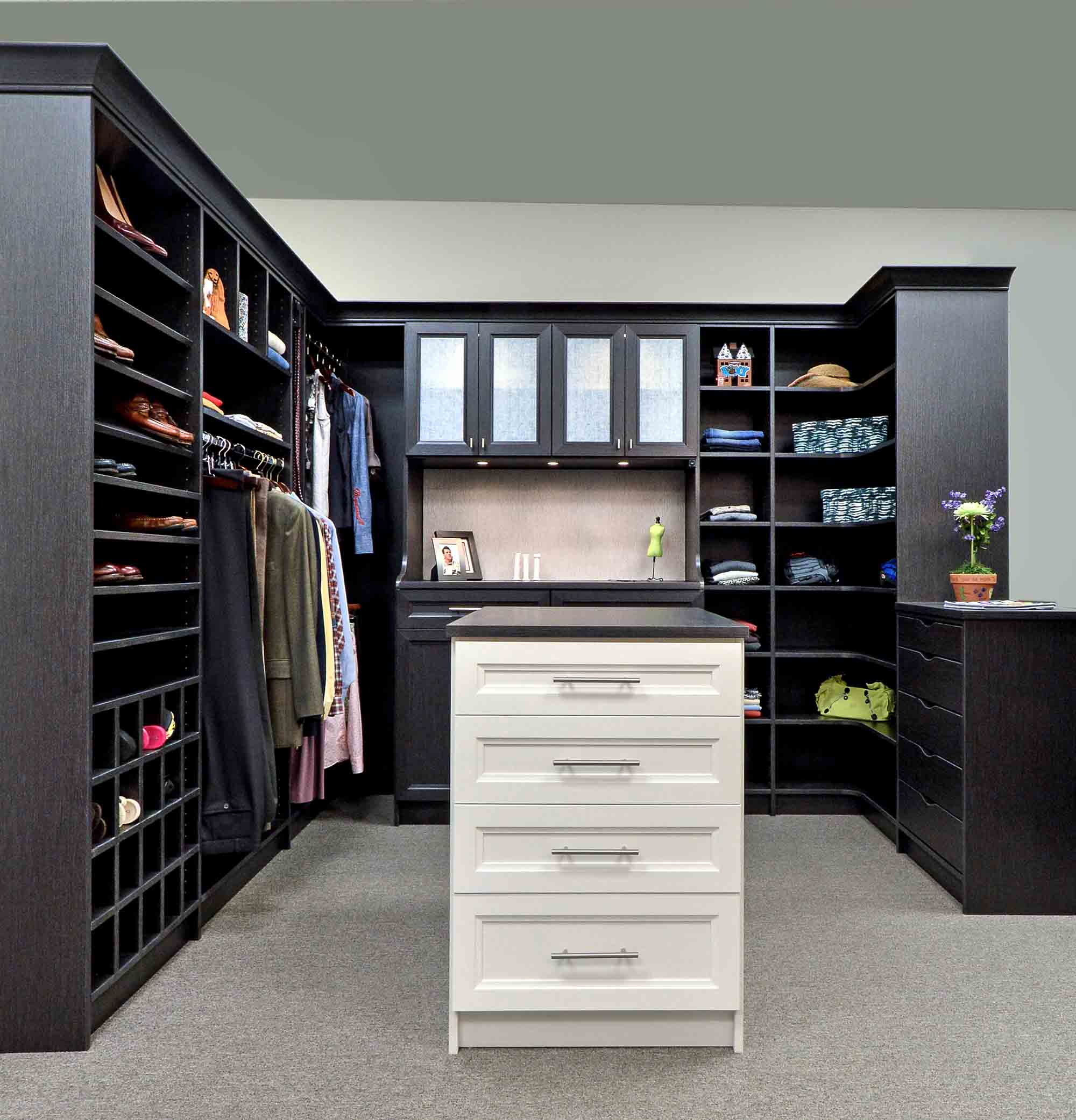 Walk in closet design idea with center island and shoe shelves