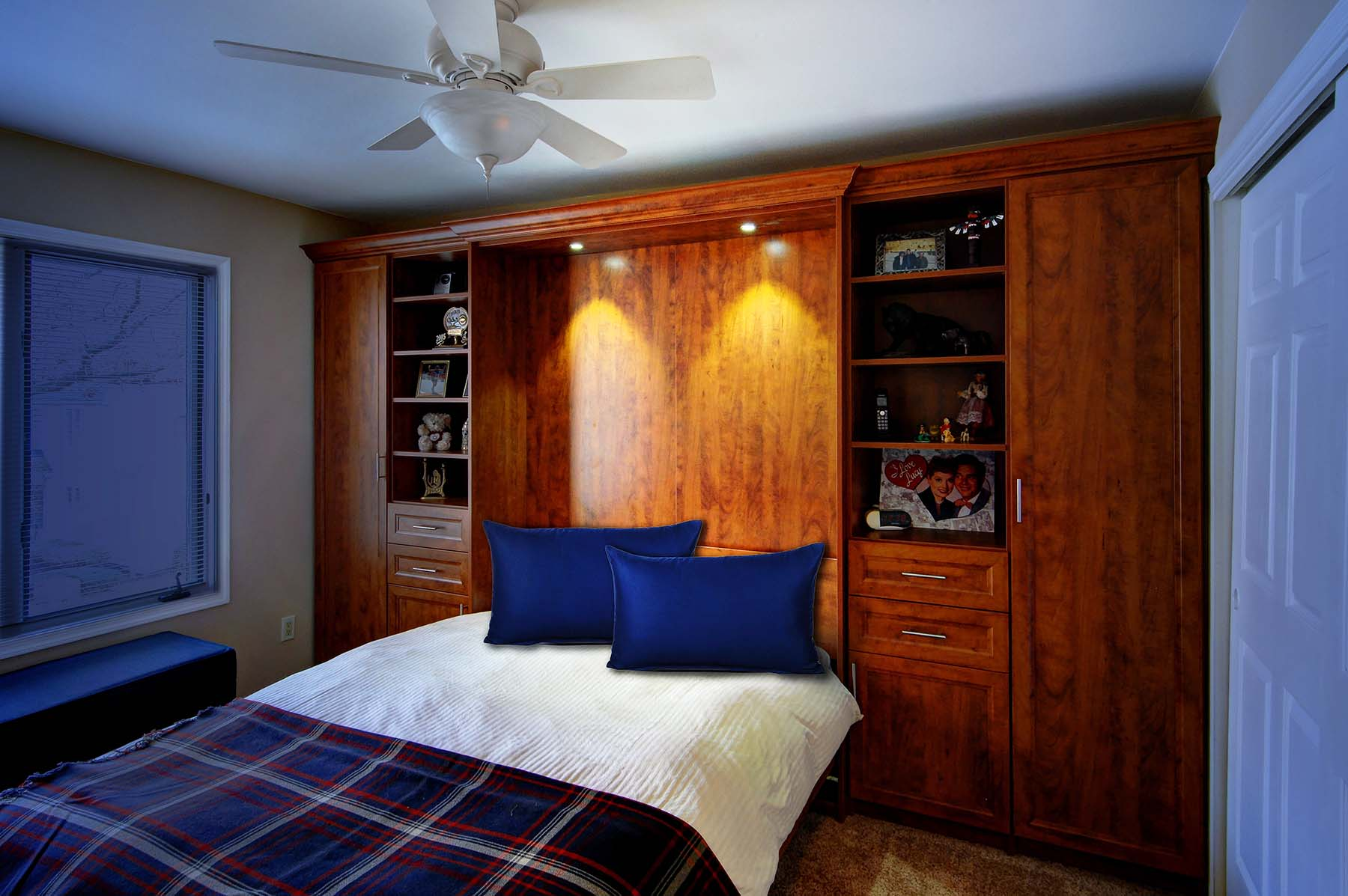 Murphy bed neatly made for guests