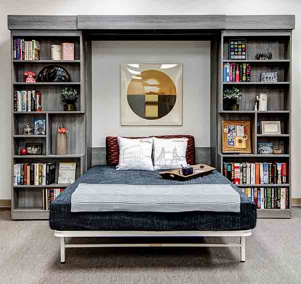 Sliding bookcase Murphy bed open and bed pulled down