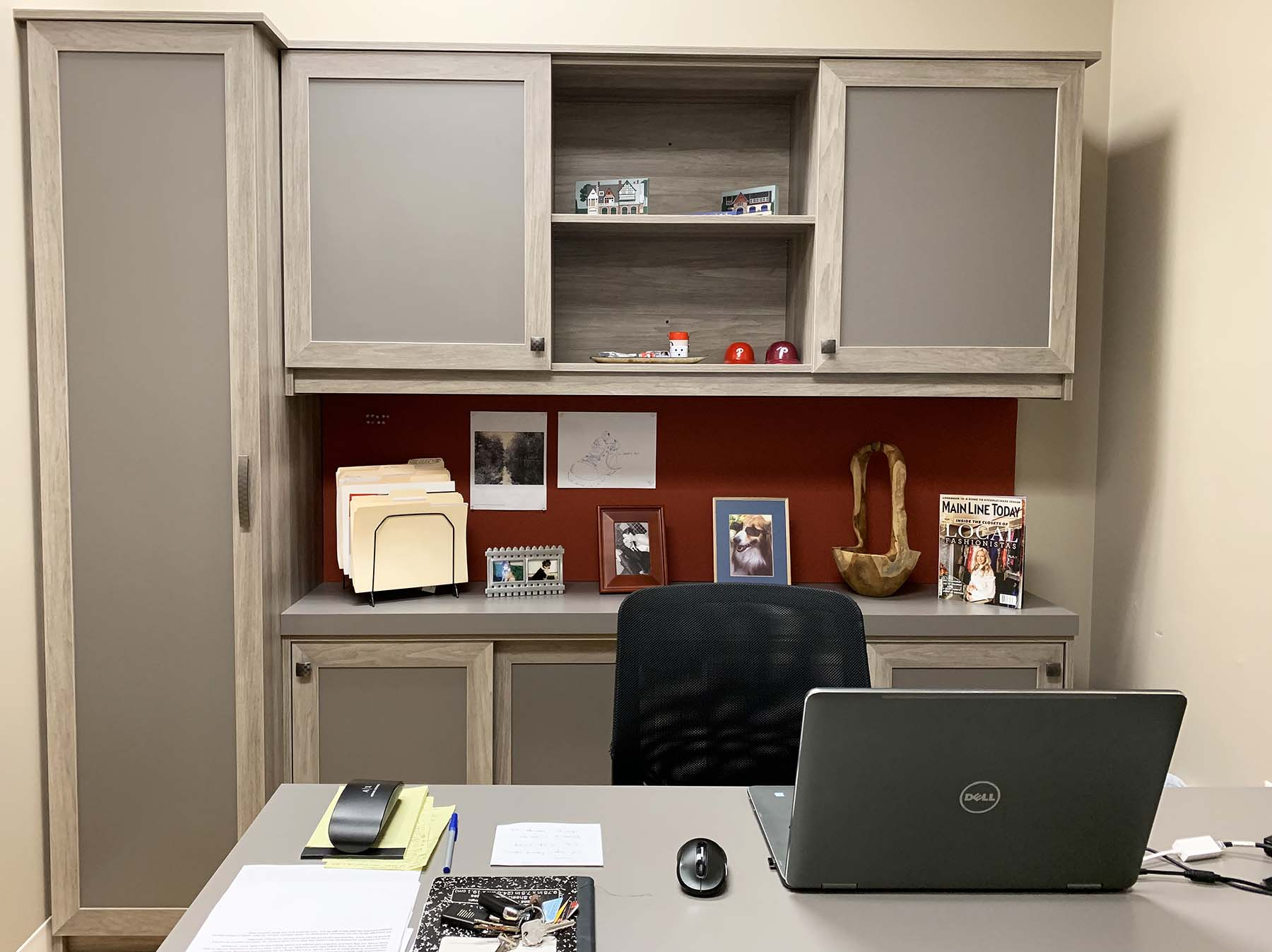 Decluttered home office with laptop on desk and matching cabinets