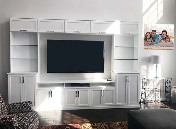 Media and entertainment center with raised panel doors and open shelving