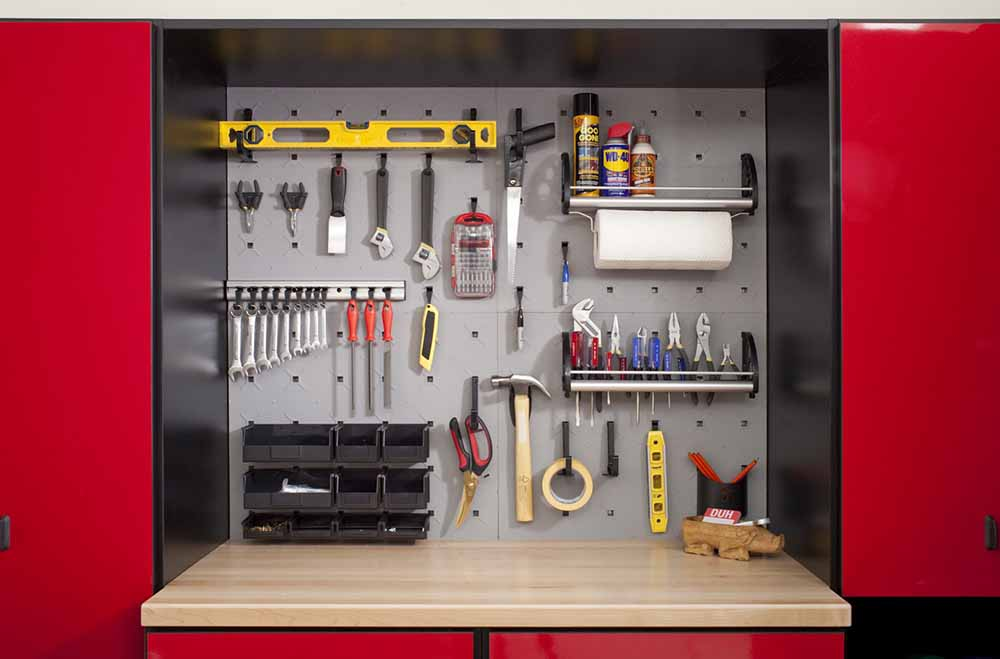 Garage tools neatly organized on wall rack