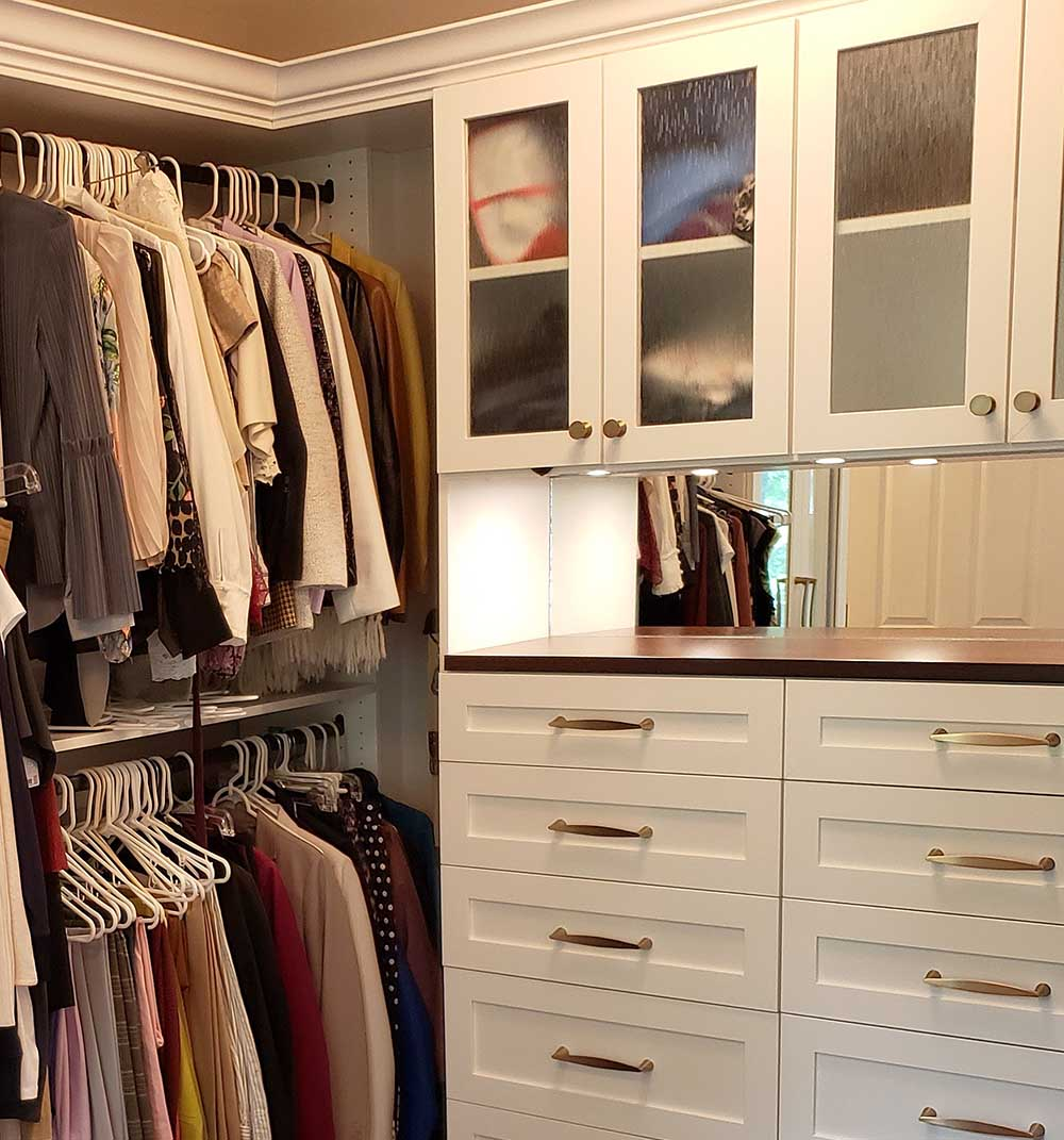 Custom closet with organized clothing