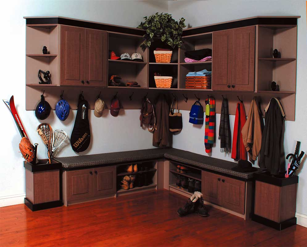 Mudroom with sports gear neatly organized in home