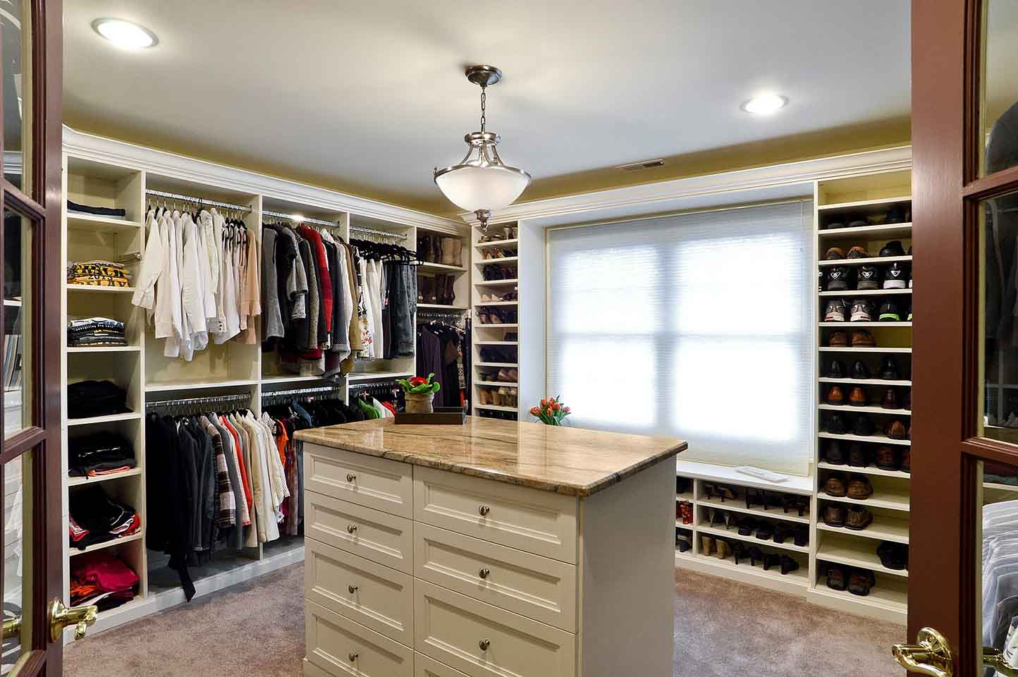 Walk-in closet with wardrobe neatly managed and organized