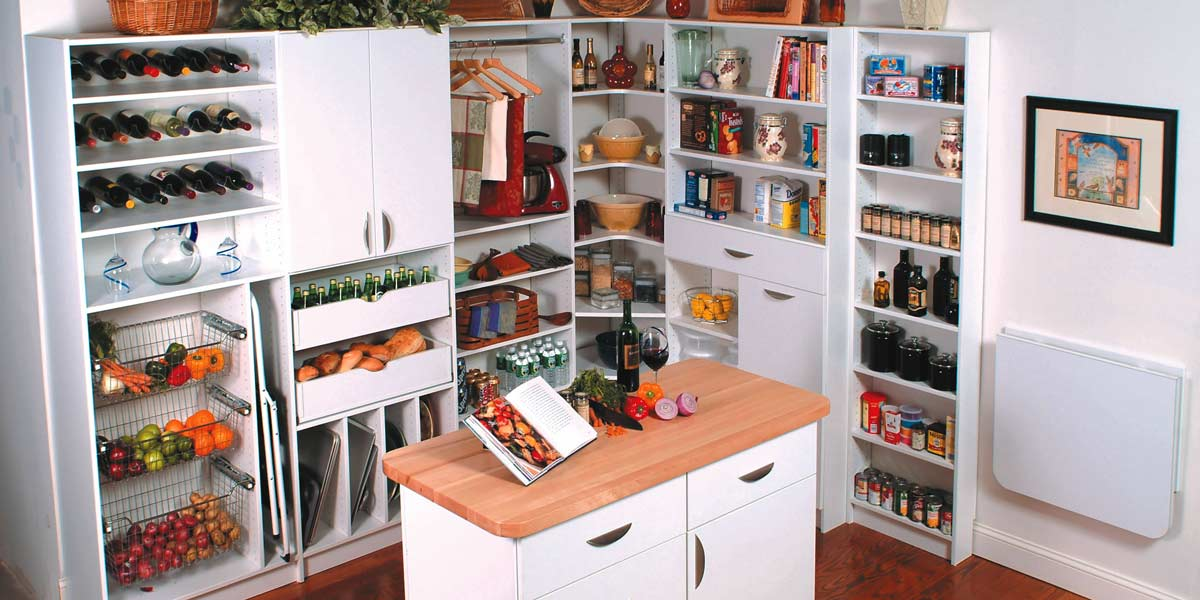 Organized kitchen pantry with center butcher block island and Lazy Susan