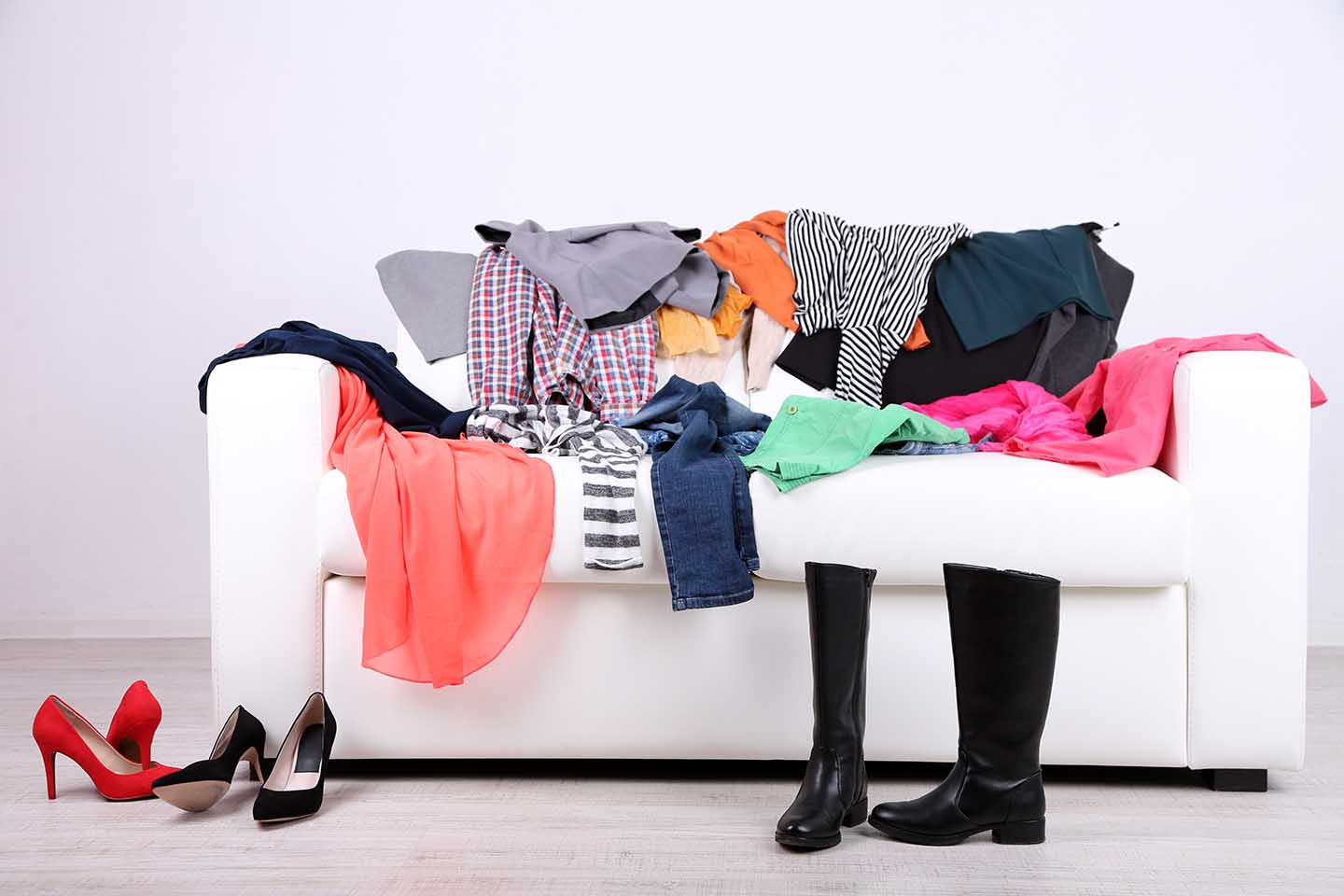 Clothing disorganized on couch