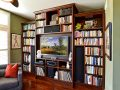 Custom built bookshelf with crown molding and entertainment center space