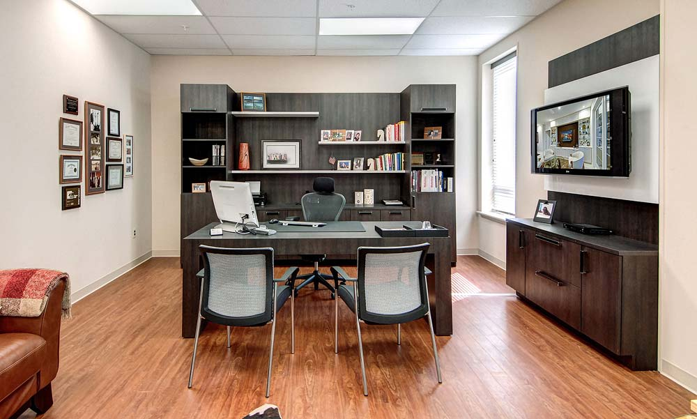 Modern office design in commercial office space with custom furniture